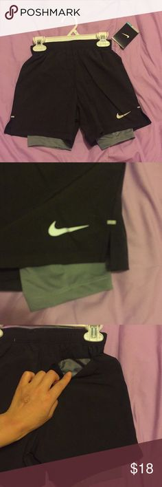 Nike 6T boy shorts Nwt. In perfect new condition. Dri fit. Black shorts with grey leggings lining. Back pocket. Side slits. Reflective Nike logo. No trades. Nike Bottoms Shorts