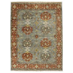 Hand-knotted wool rug with an Oushak-inspired design.  Product: RugConstruction Material: WoolColor:...
