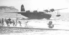 A Kawanishi H8K Type 2 delivering supplies to a Japanese held island garrison.