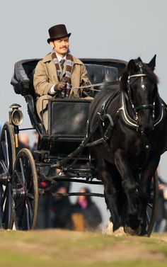 "Jude Law drives a carriage to the location of the gypsy camp scene in ""Sherlock Holmes: A Game of Shadows"""