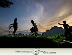 "Photo of the Day - March 23, 2012: ""Catching fish 'n' snake."" Taken by Olivier Boëls (Brasilia, Brazil). Photographed September 2008, Vang Vieng, Laos."