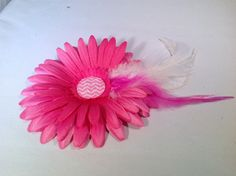 A personal favorite from my Etsy shop https://www.etsy.com/listing/226702545/pink-flower-with-pink-and-white-feathers