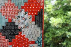 Courthouse Steps quilt pattern is great for using scraps! Wonderful inspiration :) ~ townmouse.typepad.com