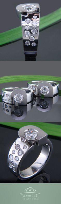Custom carved and cast platinum gent's rings in platinum featuring a ¾ bezel-set center diamond and flush set diamonds along the shoulder.