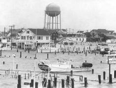 Extensive flooding ( Baltimore Sun photo by Clarence B. Garrett ) The storm is considered worse than the hurricane that hit the seaside town in 1933. Strong winds and an especially high tide caused flooding in Ocean City and along the coast.