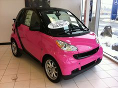 Pink Smart Car! It's actually my daughter that wants this. But it is cute. Just not very practical for midwest winters.