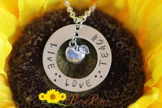 """❤ LIVE LOVE TEACH NECKLACE DESCRIPTION: Personalized stainless steel disc with """"Live Love Teach"""" hand stamped on the disc with apple charm by Pretty Prairie Designs. Makes a great teachers gift. #personalizednecklace #inspirationjewelry #handstamped #teachersnecklace"""