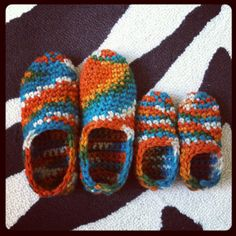 Mommy & Me Slippers Design by @Nicole Winer for @Bernat Yarns Free pattern on their blog for adult size. I modified to fit my toddler. Yarn: Softee Chunky in color: Kimono (2 balls made both pair!)