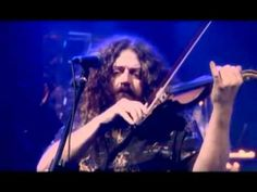 Kansas - Dust in the Wind Subtitulada (that means Spanish subtitles).  This is a live performance, and it's great it only for the strings; the singer is totally screwing it up.