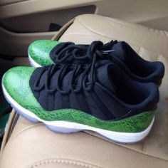 save off fd45e fcf4d The Air Jordan 11 Low GREEN SNAKESKIN release date is set for April. Black  mesh is wrapped with green snakeskin leath.