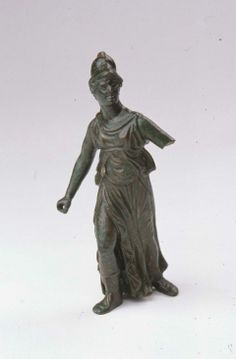 Statuette of Athena in combat Roman, Imperial Period, 1st–2nd century A.D. Bronze figure of Athena in combat. She wears a crested Corinthian helmet, a long chiton pinned on both shoulders and tied high up around the waist, and panther-skin boots. The garment has a sleeveless tunic falling to the lower middle of the body and long skirts that flow in folds and zigzags to the ankles. Her adversary was probably a giant.