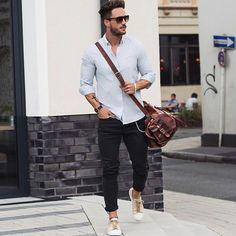 white shirt and black carrot pants, worn by man with sunglasses, business casual men, with brown leather crossbody bag, and cream sneakers