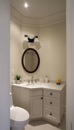 Uniquely Shaped Bathroom With White Vanity