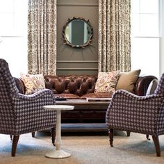 leather sofa, houndstooth chairs