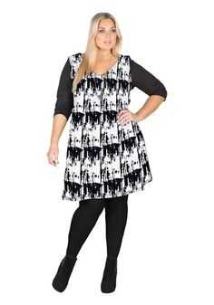 This monochrome trapeze swing dress nods to the 60s mod look with this abstract black and white print dress. For a modern take on the retro look, wear with ankle boots and sleek hair.     Viscose Elastane Jersey Black / White
