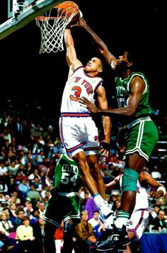 John Starks goes strong to the basket over Robert Parish at Madison Square Garden in New York.