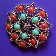 "Vintage Sarah Coventry Brooch Faux turquoise & coral vintage brooch. Vintage. Delicate design. Stones are secure. Please ask if you have questions. Approximately 2""H x 2""W Sarah Coventry  Jewelry Brooches"