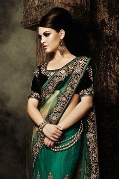Beautiful dark green sari with black velvet blouse and gold decorative trimming.