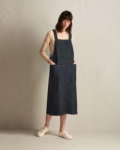 Straight-cut apron dress in a medium-weight, supple, indigo-dyed, stretch denim.