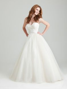 Style: 2566    A soft and romantic tulle ball gown. This design features an asymmetrically ruched strapless bodice with a sweetheart neckline and natural waistline defined with lace appliques.   Colors:	 White, Ivory, Ivory/Champagne  Fabric:	 Lace and Organza  Sizes:	 2 - 32