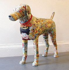 Comic covered dogs by Justine Smith who also makes sculptures likes flowers and other small things out of actual money.