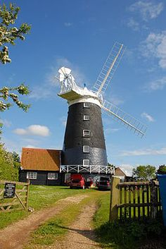 Burnham Overy Staithe Windmill This great attraction is just a few miles from Chapel Cottage Norfolk. Norfolk Camping, Norfolk Holiday, Holland Windmills, Norfolk Coast, Burnham, Interesting Buildings, Water Tower, Le Moulin, Great Britain