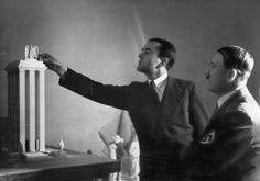 Albert Speer presents Hitler with a model of the German Pavilion designed for the World's Fair in Paris, 1937. Mary Evans Picture Library