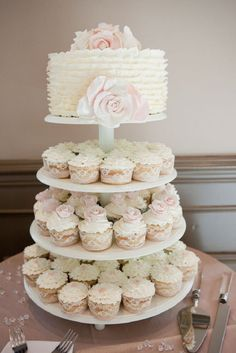 Classic White Wedding Cake with Cupcakes in Lace Wrappers - 18 Floral Spring Wedding Cake Ideas | GleamItUp