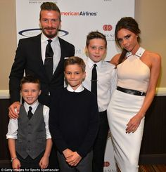 Picture perfect family: Victoria and David took their three sons (L-R) Cruz, Romeo and Brooklyn to the Sports Spectacular event earlier this month