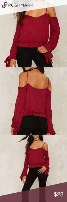 Nasty Gal Red Slip Away Off-the-shoulder Top Nasty Gal Red Slip Away Off-the-shoulder Top. Absence makes the heart grow fonder. The Slip Away Top is red and features a cold shoulder design, slight v-neck, relaxed crop silhouette, elastic waist, and ties at sleeves. More of a deep red. Bought from Nasty Gal - brand is Emory Park.  New/In original shipping bag   Product Details: •	100% Rayon •	Hand Wash Cold •	Size Small – I feel it fits more like an XS. It's more cropped than it looks like in…