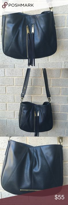 Steve Madden black bag Brand new bag with tags. Comes with 2 straps . Can be worn with either . One of the straps is studded and one is plain. Top snap button closure . Inside has one zip pocket and 2 slip pockets . Steve Madden Bags Crossbody Bags