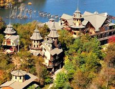 """Castle Rogue's Manor in Eureka Springs, AR    Price: 1.8 million    The Skinny: A massive and secluded mountain castle that could potentially provide residence for the masses. Also includes a six-floor """"Gate's Keeper"""" cottage, great hall and other structures.    Bonus Zombie Defense Feature: A pair of guard towers and other tall structures for scouting and medieval archer (and sniper) defense."""