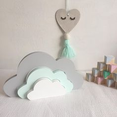 This beautiful freestanding stacked cloud is made up of 3 wooden pieces, and hand painted by myself. It would make a stunning addition to a girls or boys nursery, or even an older childs bedroom. I love the pastel colours, but I can also paint them in any colours to match your