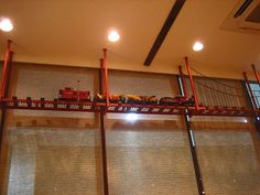 I have always wanted a model train's track suspended from the ceiling, model steam engines racing around. I like the idea of it looking like the golden gate bridge.