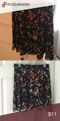 Floral skirt Xhilaration floral skirt. Elastic waist band. Never worn. Xhilaration Skirts Midi