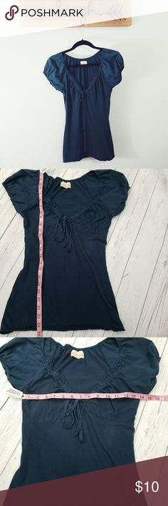 Anthropologie ben and lucia navy blue v-neck Anthropologie ben and lucia navy blue v-neck top. Slight puff on the sleeves, tie string at bottom of v-neck  neck, and more fitted body.  Cotton t-shirt type soft material in a super cute and flattering cut. Non smoking home. Anthropologie Tops Tees - Short Sleeve