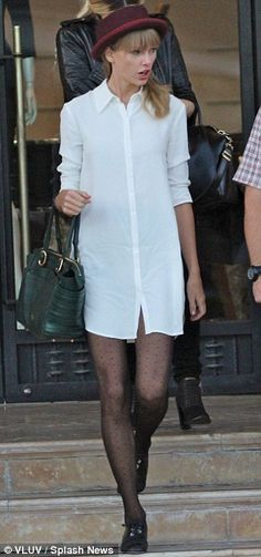 Taylor Swift wore The Reformation Fig Dress, a Free People Patton Porkpie Hat, a pair of HUE Dot Tulle Sheer Tights, a pair of Chanel Oxfords and a Christian Louboutin Farida Bowler Tote.  http://stealherstyle.net/2013/10/04/taylor-swift-white-shirt-dress-black-oxfords/