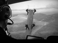 Nolan likes to keep it reel.  Seen here directing the IMAX filmed TDKR air heist from a helicopter.