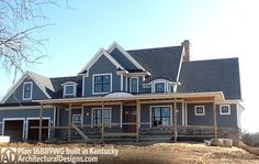 Front view of Architectural Designs House Plan 16889WG client-built in Kentucky. The plan gives you 3 to 4 beds, 3 baths and over 2,400 square feet of living. Ready when you are. Where do YOU want to build?