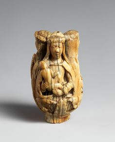 French (?). Rosary terminal bead with the Virgin and Child, Saint Barbara, and Saint Catherine.. 15th century. Ivory. Dimensions: Overall: 2 1/2 x 1 5/8 x 1 1/2 in. (6.4 x 4.2 x 3.8 cm). Public Domain.