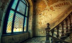 Love this stairway and window with its beautiful stained glass in this abandoned palace in Poland.