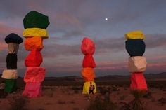 Brightly colored 30-foot-tall totems light up the desert sky just outside Las…