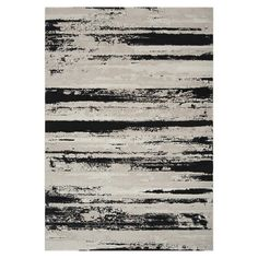 Anchor your living room seating group or define space in the den with this Turkish-made rug, showcasing an abstract motif for eye-catching appeal.