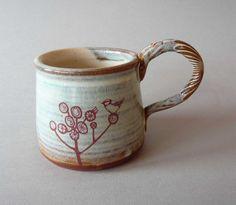 red bird in tree mug