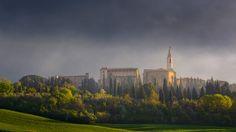 Pienza - Dramatic, beautiful light reveals the Duomo and palaces of Pienza, Tuscany, Italy