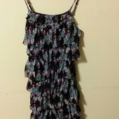 Express ruffled dress.  Paisley print. A size small.  Worn once.    Black ruffled dress.  Knee length. Paisley print. Green, white, purple colored.  Spaghetti straps.  It's stretchy so I feel it could fit a smaller medium too.   It could be used in the summer with cute sandals. I used to wear it more with tights flats and sweaters in the fall. Express Dresses