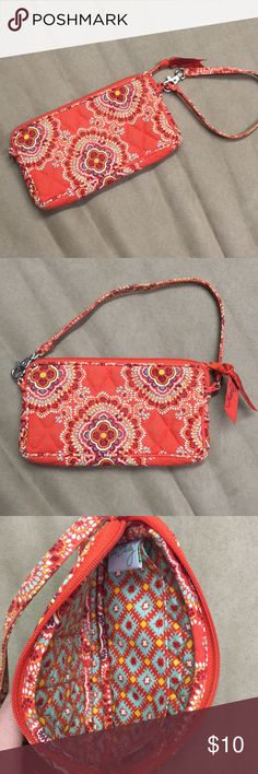 Vera Bradley clutch/wristlet Excellent condition! Wristlet strap can be hooked onto either side. Small - fits an iPhone, lip gloss, credit card and car key. Vera Bradley Bags Clutches & Wristlets