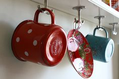 When space is tight, hooks are your friend. If you have pretty things to hang: Boom! They're a feature!
