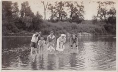 Old Vintage Antique Photograph People Standing Bent Over in The Water