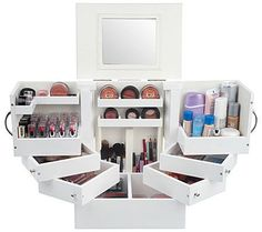 Avoid the cosmetics crush with this deluxe wood makeup box with built-in mirror. Spacious and separated into four different levels with swing-out doors and magnetic closures, it offers ample room for 30 lipsticks and numerous other cosmetics, like blushes, shadows, pencils, mascara, foundations, nail polishes, and more. From Lori Greiner. QVC.com